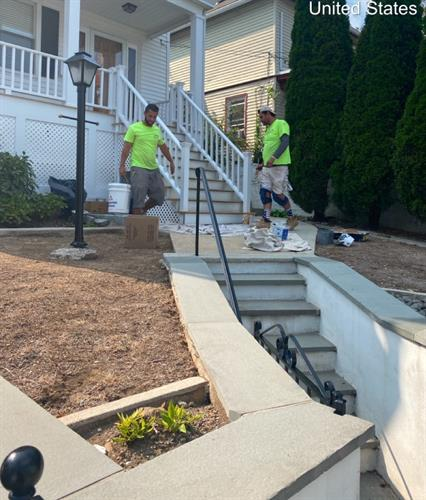 Painters working hard to prep these stairs for new paint!