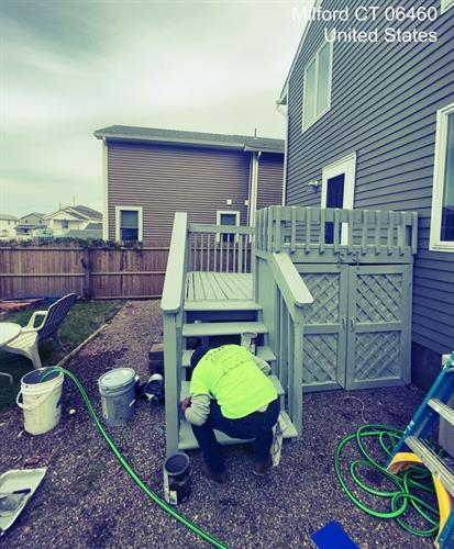 Deck staining during a full exterior paint project.