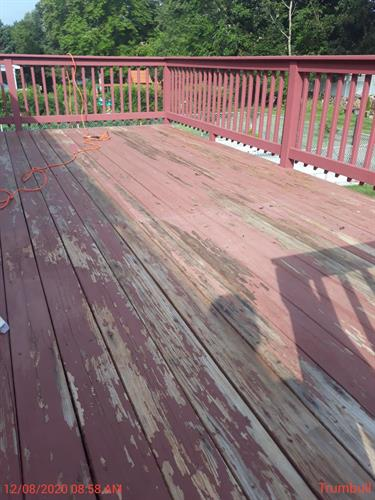 Sanding off the peeling paint for this deck