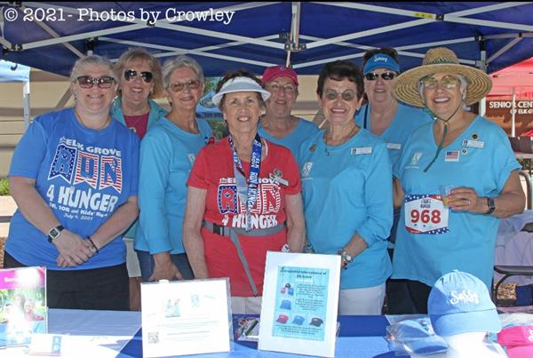 Here are some of our members at our booth at the 17th Annual Elk Grove Run 4 Hunger by Stephen Crowley Photographyenefitting Elk Grove Food Bank.