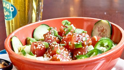 Local favorite, fresh tuna poke with our house made picked cucumbers and sriracha dressing.