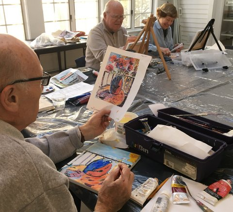 The art workshop has artists of all levels with a talented instructor to guide them.