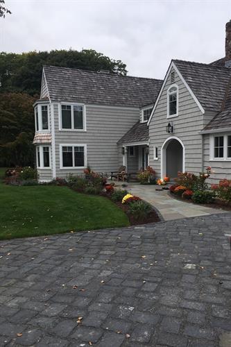Cobblestone driveway, blue stone walkway, plantings, mulch, new lawn!