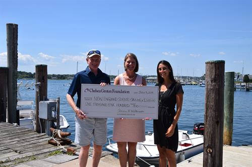 Chelsea Groton Foundation presenting a donation to New England Science &Sailing in Stonington