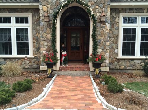 Brick pavers walkway, with herringbone brick layed on porch.