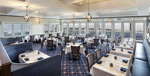The Wharf Restaurant, open year-round, with perfect views of the Long Island Sound and both sunrise and sunset.