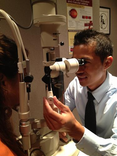 Dr. Yap performing a slit lamp examination. The slit lamp enables the physician to view the front surface of your eye (e.g. lids, cornea, lashes) and inside your eye
