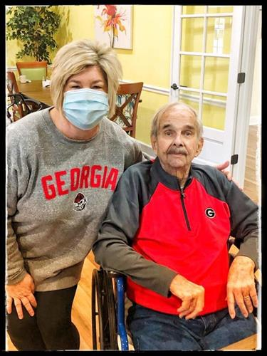 Kim Hall is twining with one of the residents. Go DAWGS!
