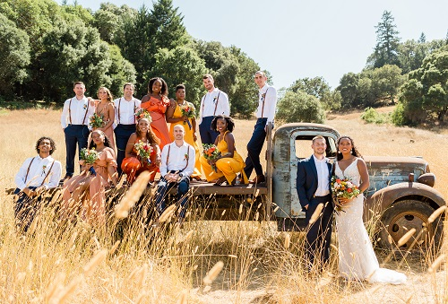 Wedding party photo around rustic truck at Mountain House Estate.
