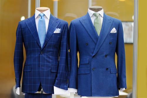 Gallery Image bigstock-Beautiful-Blue-Suits-On-A-Mann-179405296.jpg