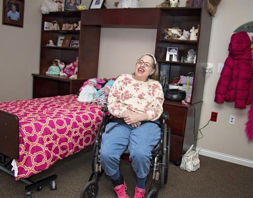 Person supported enjoying her new home at Sycamore Run, our community based Intermediate Care Facility.