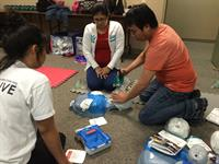 First-Aid4All students practicing their AED skills.