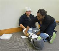 First-Aid4All students practicing their splinting skills.