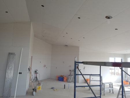 New home construction at boarding stage of curved wall against vaulted ceiling. Airdrie