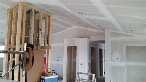 Taping stage of a new home with vaulted ceiling