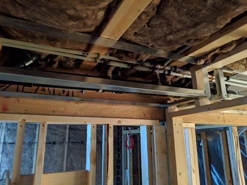 We offer steel stud framing around your water lines in your basement to maximize your space.