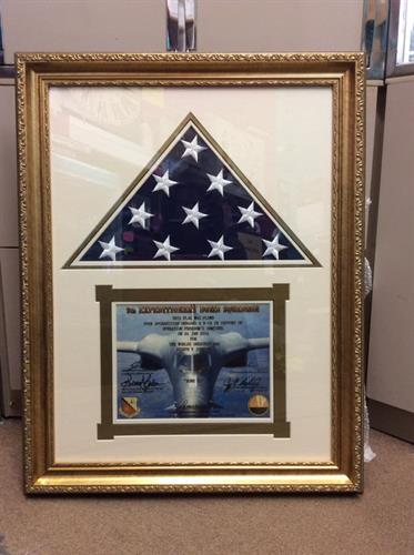 Michel was honored to professionally frame this keepsake for a client