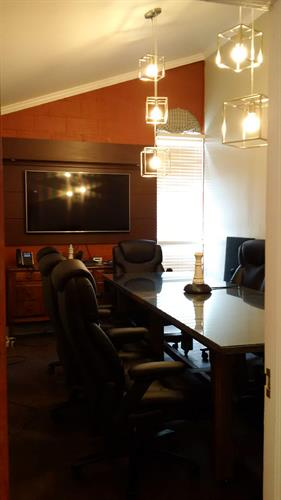"Private Office Meeting Room Allows for Privay with a 60"" Projector Monitor"