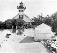 Historic lighthouse photo showing the boathouse