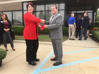 Curtis Hicks II, President and CEO of CCR shaking hands with Sterling Heights Regional Chamber of Commerce President, Melanie Davis, during the Ribbon Cutting Ceremony.