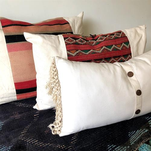 A Large Assortment of Pillows for Sale