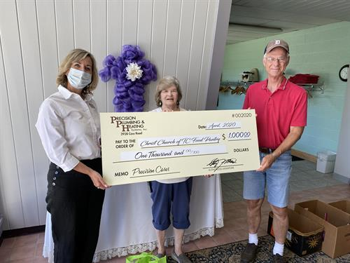 Christ Church of TC's food pantry feeds hundreds of families each month.  Precision Cares was honored to present them with a $1,000 check to assist with their food buying.