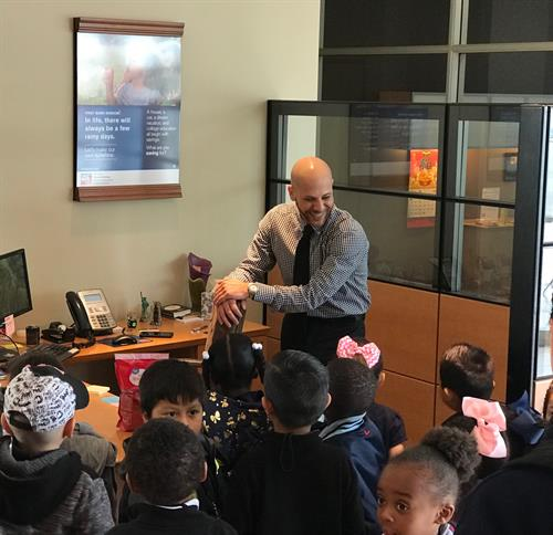 School filed trip to Bixby Knolls First Bank with Nasser Salama explaing the day in the life of a banker.