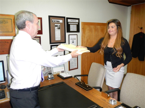 Long Beach Injury Attorney Michael D. Waks working with a member of his staff.