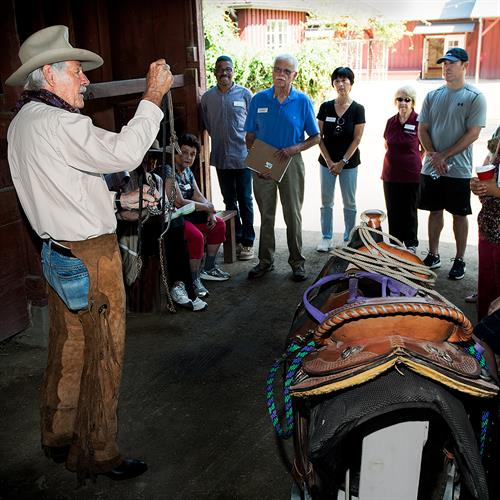 Volunteer explains equipment in the Tack Room