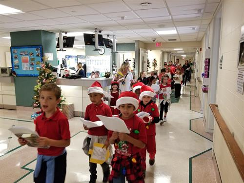 Student carolers from McNab Elementary sing holiday tunes through the halls of the hospital.