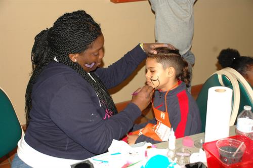 High School volunteers provided free face painting.