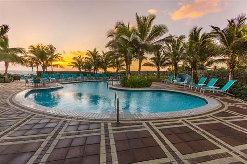 Oceanfront swimming pool at sunrise.