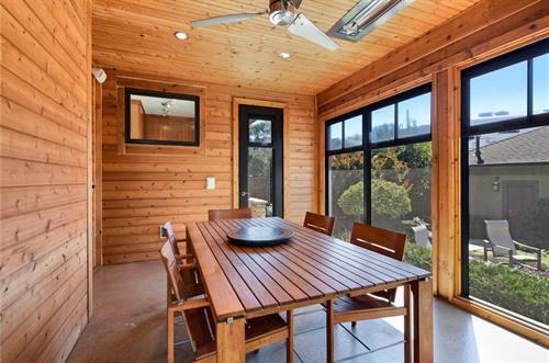 Gallery Image Three_season_porch_is_a_fantastic_extension_of_the_home_and_has_easy_access_from_the_inside_and_out._Side_door_allows_you_to_enter_from_the_back_stoop..jpg