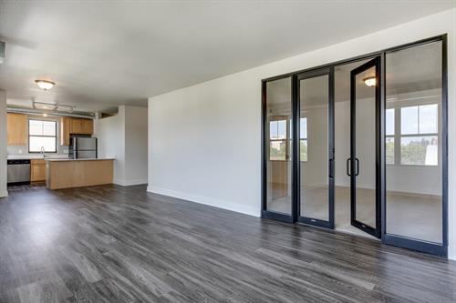Upgraded appliances and wood plank flooring