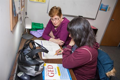 Student and tutor preparing for GED exam
