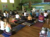 yoga teacher orientation in the auditorium
