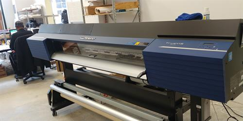 Large Format Printer. Prints for apparel, signs, labels