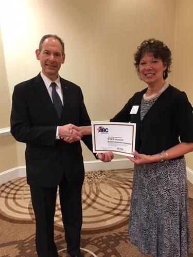 Denise Bertolet  accepting the Gold Safety Award from Associated Builders and Contractors, Inc.