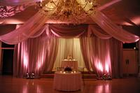 Green Valley Country Club's Ballroom set and decorated for a Wedding Reception. Beautiful draping complimenting the interior design of the Country Club.