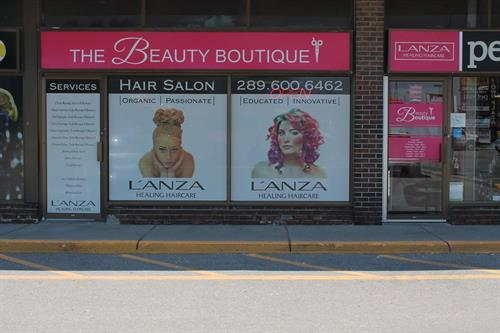 Storefront - Backlit signage, perforated window and door vinyl as well as cut vinyl graphics