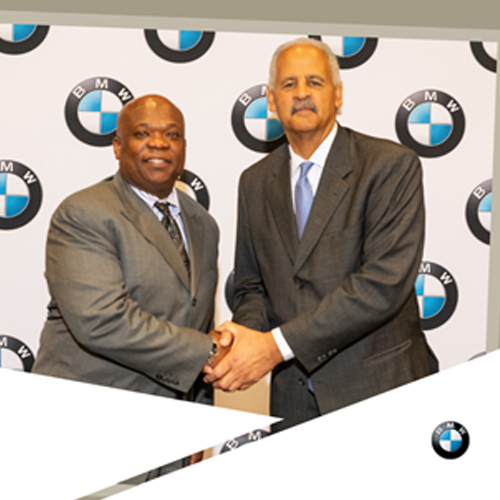 Our president taking photos with keynote speaker at BMW conference - M|R|S created the digital frame and provided photography services