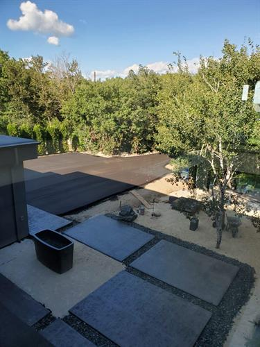 Our crews installed stamped concrete pads and an asphalt driveway at this beautiful home.