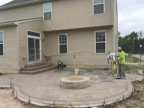 Finishing a Stamped Concrete Patio with Fire Pit