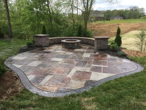 Stamped Concrete Patio with Seating Wall, Columns and Fire Pit