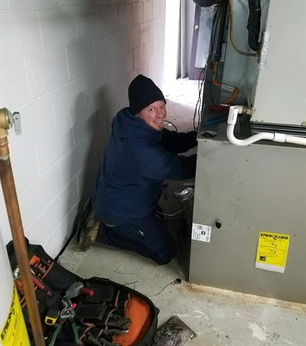 Andy installing a new Carrier furnace