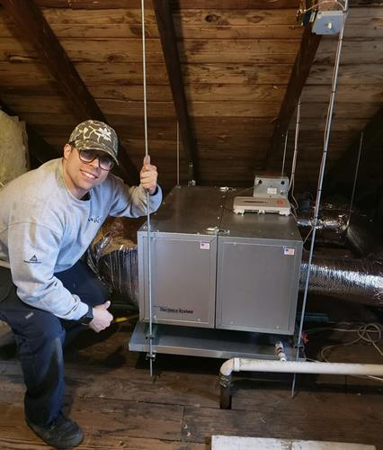 Jay installing an air handler in the attic of one of our clients