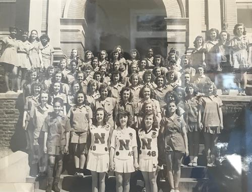 Team photo taken in front of the West Entry way in the 1940's.