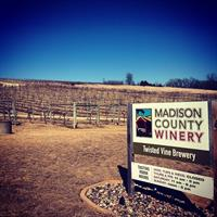 Gallery Image MCW_sign_and_vineyard.jpg