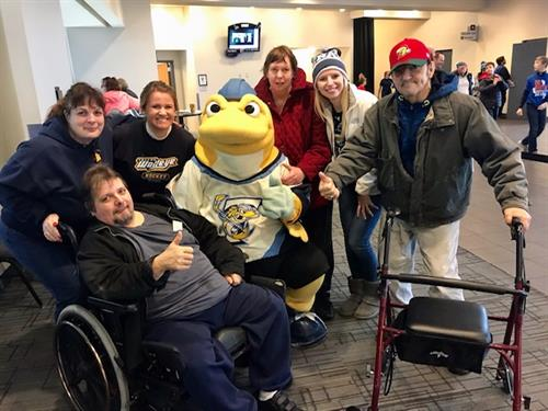 Staff and residents at the Toledo Walleye Game!