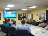 Dr Kolodziejczyk presents to employees at Crown Battery
